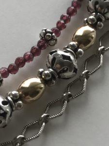 Sterling, garnet, gold-filled 3-strand bracelet.