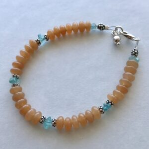 Peace Within Adorable Amazonite Bracelet Happy bracelets make for happy life! Blue amazonite stones with a pretty glass flower. Handcrafted by Anna Kerr.